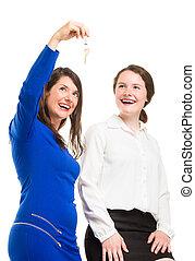 Two young business women in full li