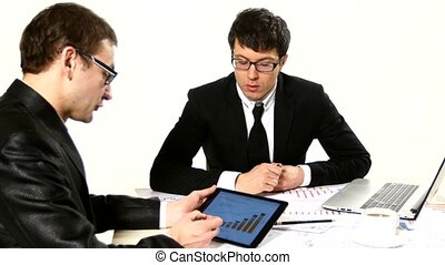 two young businessmen discussing project at meeting, developing a business project and analyzing market data information