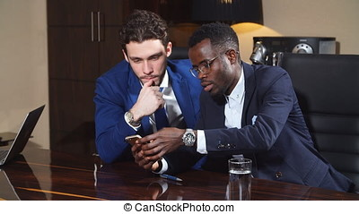 Two Young Businesspeople Having Discussion. - Two Young...