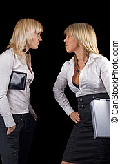 Two young businesswomen. Isolated on black background