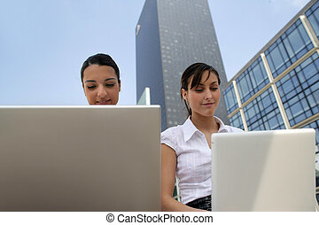 two young businesswomen working on their laptops