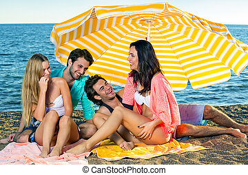 Two young couples enjoying vacation at the beach