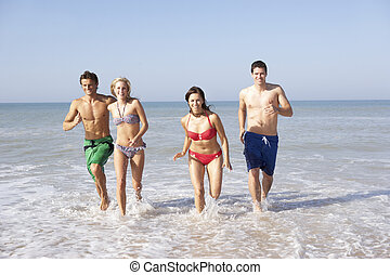 Two young couples on beach holiday