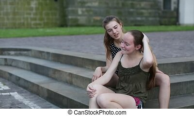 Two young cute girls sitting
