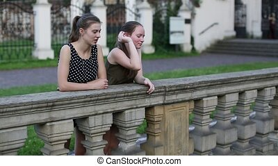 Two young cute girls standing