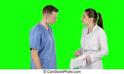 Two young doctors debating. Green screen