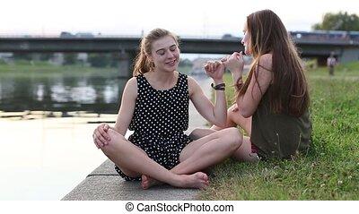 Two young girls girlfriend sitting