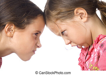 Two young grils in argument over white background