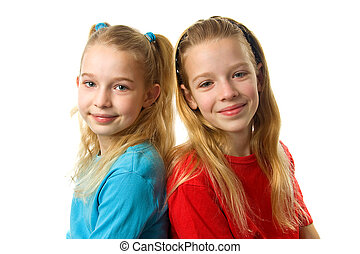 Two young girls looking in camera
