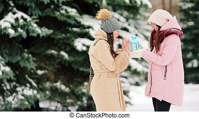 Two young girls outdoors on beautiful winter snow day