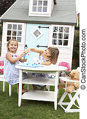 Two young girls play outdoors