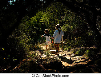 Two Young Girls Walking Through the Woods