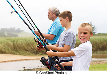 two young grandsons fishing with grandpa