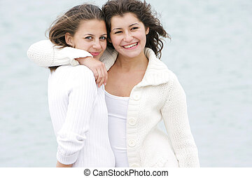 two young happy girls on natural background