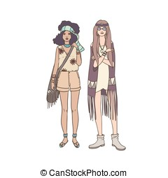 Two young hippie women dressed in stylish clothing decorated...