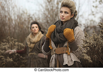 Two young ladies in autumn scenery