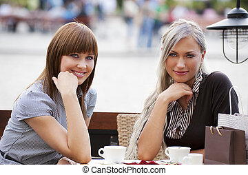 two young lady sitting outdoor