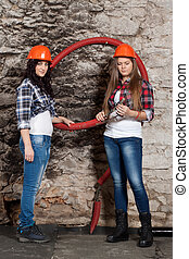 Two young long-haired woman with cables