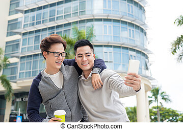 Two young man video call using smartphone