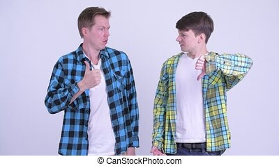 Two young men having different decisions together - Studio ...