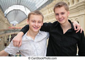 two young men indoor