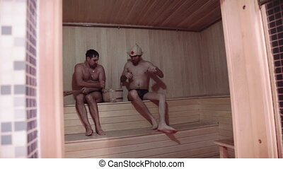 two Young men relaxing in sauna, Relaxation, weekend, sports
