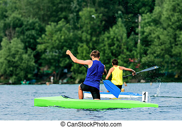 two young men rowers canoeists