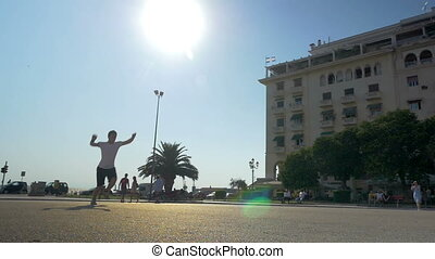 Two young men showing acrobatic exercise in the street