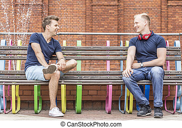 Two young men sitting on a bench