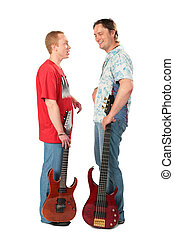 Two young men stand with guitars