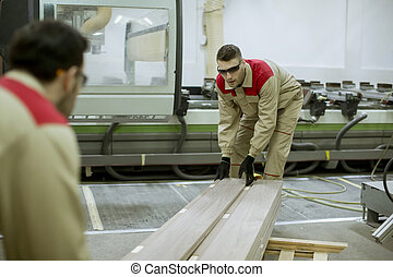 Two young men working in the furniture factory