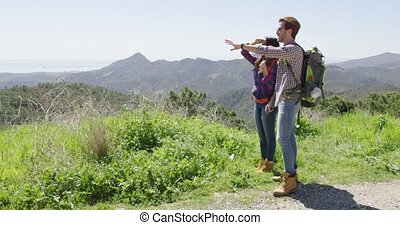 Two young people hiking in mountains - Man and woman hiking...