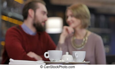 Two young people in cafe enjoying the time spending with each other