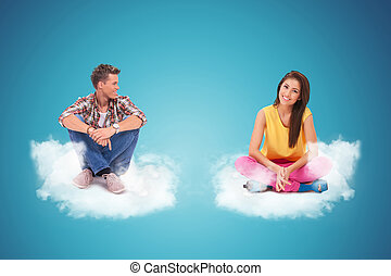 two young people sitting and resting on couds