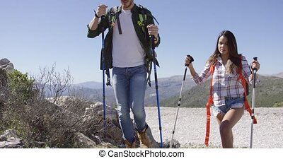 Two young people trekking in mountains - Young man and woman...