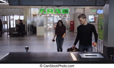 Two young persons hurry up to check in for further flight
