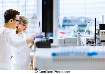 Two young researchers  in a lab