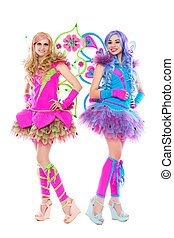 Two young smiling women posing in carnival butterfly dresses...