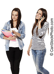 two young students one hanging on the phone on white background