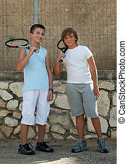 Two young tennis players .