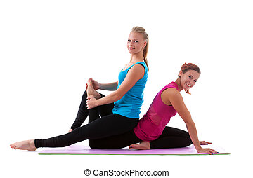 two young woman doing stretch exercise isolated