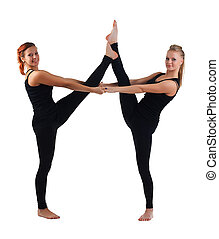 two young woman gymnast in black stand on split