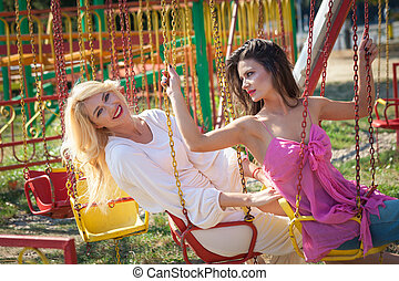 two young woman have fun in amusement park