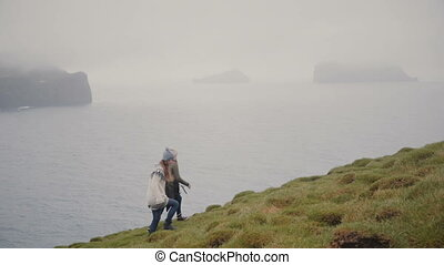 Two young woman hiking in the mountains. Traveling female...