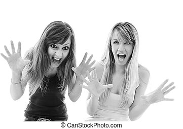 scream - two young woman scream isolated emotion pair group