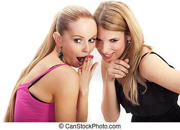 Two young woman wispering secrets