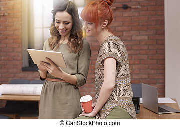 Two young women at the office