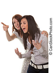 Two young women breaking into laughter - Two young girls to...