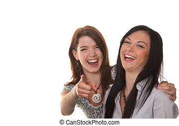 Two young women burst into laughter - Two young girls will...
