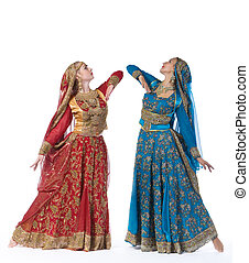 Two young women dance in indian costume